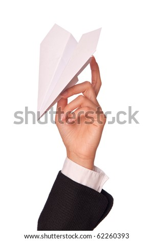 Businesswoman throwing white paper plane on the break