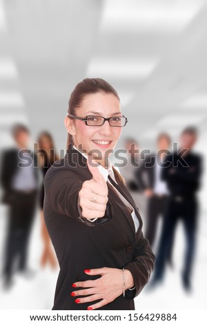 Businesswoman thumb up in front of her Business team in the office