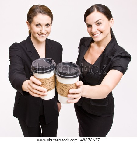 Businesswoman toasting with coffee cups