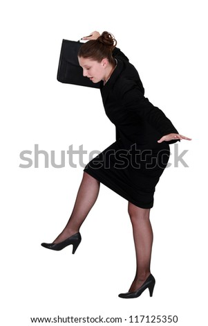 businesswoman trying to balance - stock photo