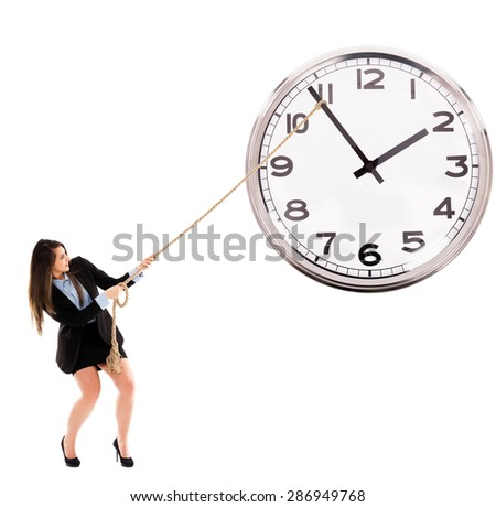 Businesswoman trying to stop the time by dragging clock tongue, conceptual image - stock photo