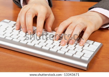 Businesswoman typing on computer keyboard. Shallow depth of field