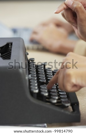 Businesswoman typing on typewriter
