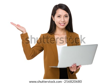 Businesswoman use of laptop and open hand palm - stock photo