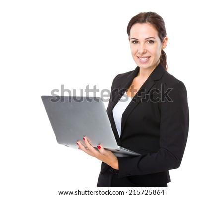 Businesswoman use of laptop computer - stock photo
