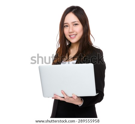 Businesswoman use of notebook computer - stock photo