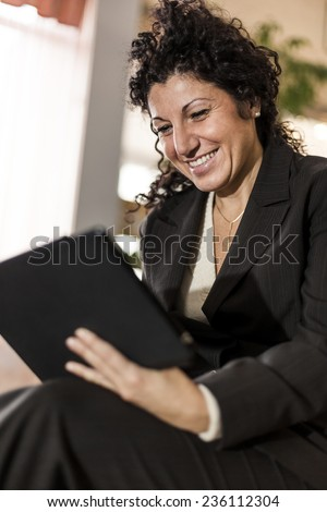 Businesswoman using a digital tablet. - stock photo
