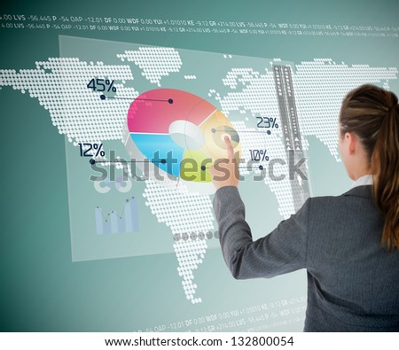Businesswoman using colorful transparent futuristic interface with map on the background - stock photo