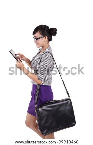 Businesswoman using digital tablet and carry a computer bag. Shot on white background - stock photo