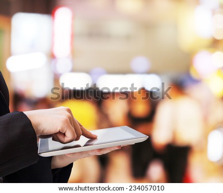 Businesswoman using digital tablet in the shopping mall - stock photo