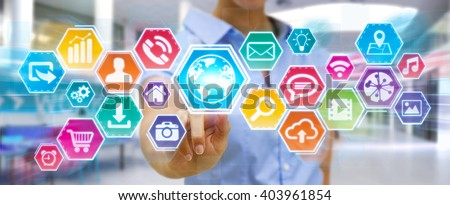 Businesswoman using digital tactile screen with web icons - stock photo