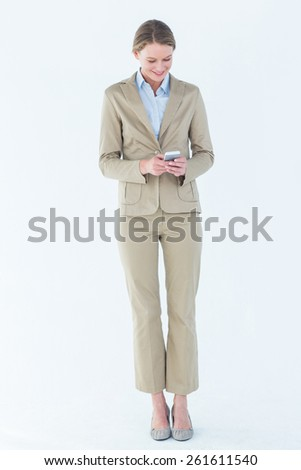 Businesswoman using her mobile phone on white background - stock photo