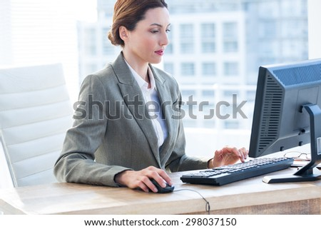 Businesswoman using his computer at the office