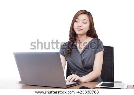 Businesswoman using laptop computer at office. Mixed race chinese / caucasian model isolated on seamless white background. have clipping paths