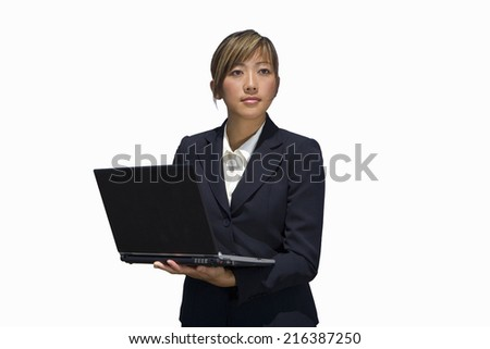 Businesswoman using laptop computer, cut out