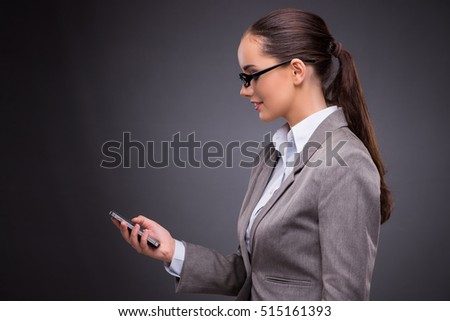 Businesswoman using mobile phone in business concept
