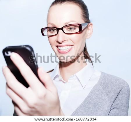 Businesswoman using mobile smart phone - stock photo