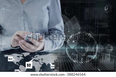 Businesswoman using smart phone against black and grey interface