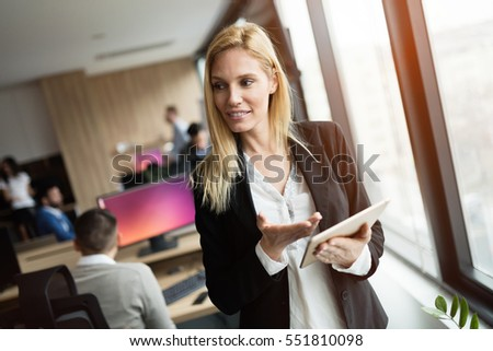 Businesswoman using tablet at information technology workplace