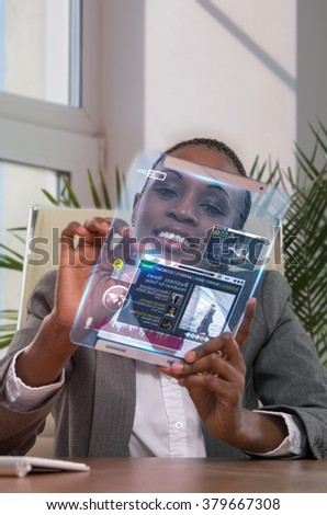 Businesswoman using tablet computer at her office - stock photo