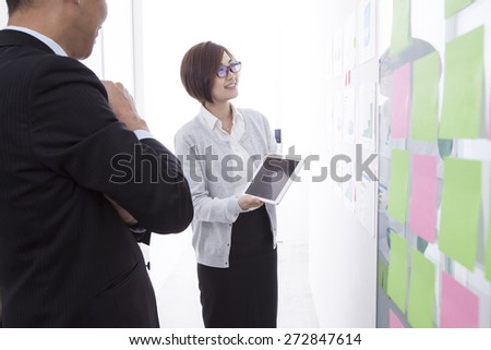 Businesswoman using tablet in the office