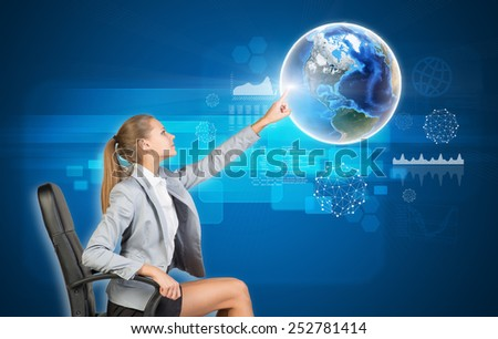 Businesswoman using virtual interface with Globe on blue background. Element of this image furnished by NASA - stock photo