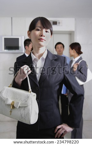Businesswoman Waiting For Elevator - stock photo