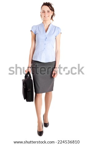 Businesswoman walking and holding a bag - stock photo