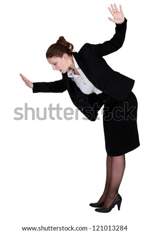 Businesswoman walking imaginary tight rope - stock photo