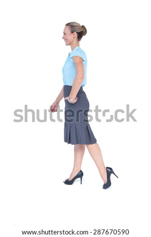 Businesswoman walking on white background - stock photo