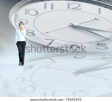Businesswoman walking through the abstract background - stock photo