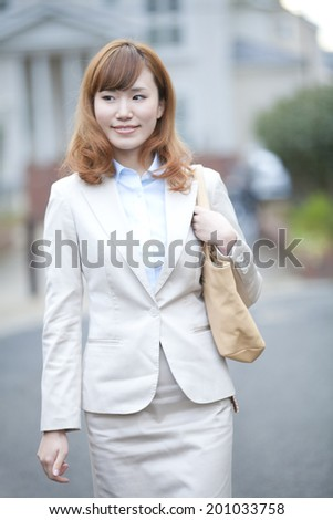 businesswoman walking with a smile