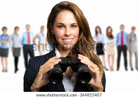 Businesswoman watching through binoculars in search of new opportunities