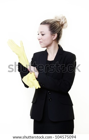 businesswoman wearing rubber gloves getting ready to do some cleaning up at work - stock photo