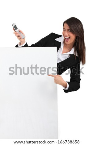 businesswoman winking and holding a cell phone - stock photo