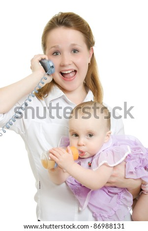 Businesswoman with a baby in her arms on the phone.