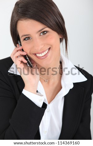 Businesswoman with a cellphone - stock photo