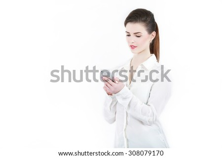 Businesswoman with a mobile phone - stock photo