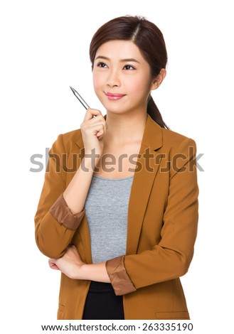 Businesswoman with a pen in her hand - stock photo