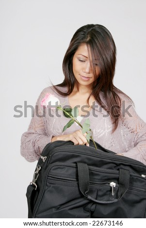 Businesswoman with a rose and an attache