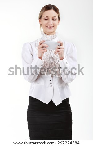 Businesswoman with a white mobile phone - stock photo