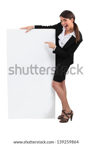 Businesswoman with advertising board - stock photo