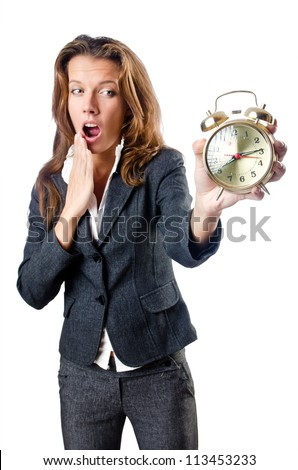 Businesswoman with alarm clock on white