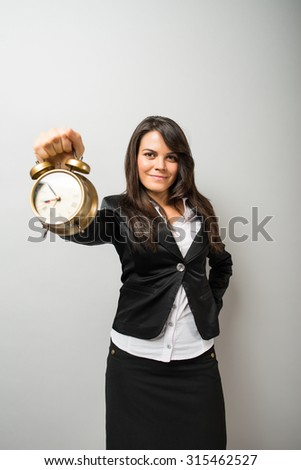 businesswoman with an alarm clock