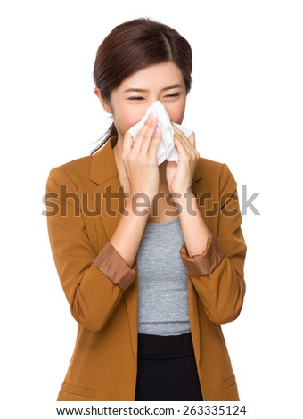 Businesswoman with an allergy sneezing - stock photo