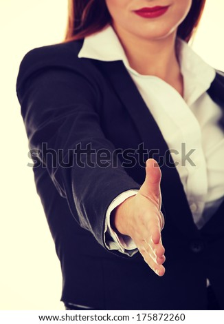 Businesswoman with an open hand ready for handshake  - stock photo