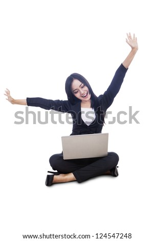Businesswoman with arms raised and laptop isolated over white