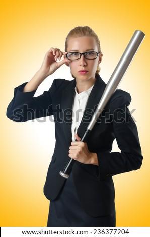 Businesswoman with baseball bat on white - stock photo
