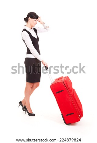 Businesswoman with big, red suitcase, traveling, white background, full lenght - stock photo