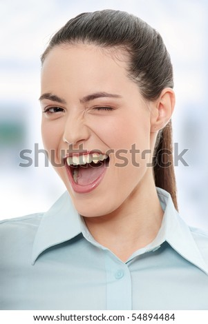 Businesswoman with big smile blinking. - stock photo